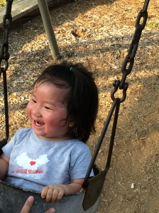 Holding herself upright in a swing is good for developing her stomach muscles.