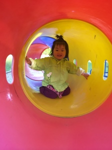 Maggie finally learned to crawl--through a tunnel at the park!