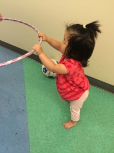 The physical therapist suggested letting her walk holding a hula hoop so she has a sense of stability but has to rely mostly on herself. She tried it once, but afterward she refused to do it again--she just lowers herself to the ground and refuses to budge.